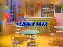 Sweet Lips. An ice cream shoppe becomes the site for all kinds of carnal cavorting - when it's run by Herschel Savage and Tom Byron, that is! Tom plays a young stud who can not help but be attracted to vivacious counter girl Blair Castle, but his boss warns him to keep his hands off. Meanwhile, Herschel's up front chatting with come-hither customer Kimberly Carson. While she tells him all about her troubles, he dreams up a delirious dalliance with Kimberly that lays bare his freakiest fantasies. And after he closes up shop, Tom finds himself confronted with Blair's irresistible charms. The couple get down and dirty right there in the shop! Ice cream's the only thing that's not red hot in this wild romp from the 80s!