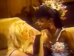 Vintage black and white lesbians. Angel Kelly and a blonde girl fucking, barefoot.