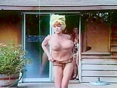 "Female Chauvinists. This sex comedy is filled with lesbian and/or outdoor sex scenes.Big busty models of the past Uschi Digard, Candy Samples and Roxanne Brewer show their ample wares. The movie starts off with Roxanne(a redhead with an impossible bust) and her boyfriend hard at it, when their flatmate turns up.Roxanne Brewer goes ""undercover"" to help expose the group . Her boyfriend poses as a mute gardener and a photographer friend around.UschiDigart has a dream about a sperm bank and token black Deborah McGuire masturbates with a Dr. Pepper flask.They plan for Roxanne to join an all Girls against Males sect, where most of the girls are big and busty. The highlight of the film is Roxanne riding a horse topless chasing her Boyfriend.There are plenty of laughs and plenty of big busty topless action. Other than doing some adult loops, Roxanne also did a few other cheap"