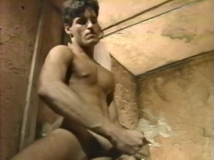 He-Devils. This narrated story has Lon Flexx dreaming of beefcake Alex Stone in a railroad tunnel. Alex strips from macho clothing and fondles his chest and tits. Rubbing his tits hard, Alex jacks off, as the camera offers larger-than-life close-ups. Both Lon and Alex take to beating off in this red-lighted segment. Later, after Lon wakes, his buddy and traveler, Michael Brawn, imagines himself with lovely Lon in a bathroom of a hotel. Uncut and handsome Michael sucks Lon off before being fucked up the ass. Their oral sex is excellently photographed, too, with lots of saliva dripping from cock and mouth. This long segment continues with huge close-ups of Lon sucking Michael's fat cock.  Lon spies Butch Taylor and Sean Fox, next, in a fantasy room through a hole in the bathroom wall. Butch, in chaps, gets a blow job from Sean as he squats on the bed. Larger-than-life close-ups follow this action well, as we also see Alex there, beating off to the action. Butch fucks Sean up the butt both doggie and missionary-style before all three shoot big cum loads. Brad Phillips joins J. Jenkins in a wood shop. As Lon watches from the doorway, Jenkins licks Brad's crotch in his jockstrap. Lots of jock-licking precedes a well-photographed blow job and some intense foreplay. They 69 for a time until Brad fucks the man hard and deep on the workbench. Huge close-ups of fucking really bring this home to the viewer.  Michael joins a bartender (cute, tattooed, lean, and hung) for hard doggie-fucking and long-dicking in the mouth and butt. A final scene has Alex and Lon in a fast and intense scene.