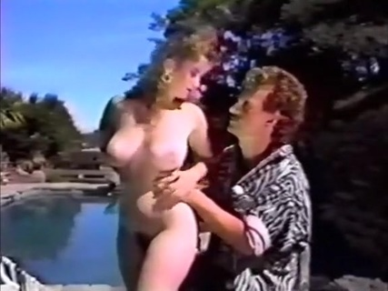 Jeanna Fine gives poolside BJ. In the 1989 movie California Taboo, babe Jeanna Fine gives a blowjob to stud Joey Silvera before the couple fuck on a float.