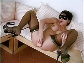 Masked chick stuffing her hungry pussy. A brunette milf wearing a mask goes for a hot and hard masturbation display for her man.
