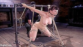 Homewrecker Revenge - HogTied. Olive has a body that is the closest to perfection that we can think of. Her perfect perky tits and firm round ass, along with the face of an angel, makes for the perfect slut. The Pope incorporates some cold steel for him to use as way of tying her in brutal predicaments. She is held in a extreme squatting position with her legs spread wide. She squirms and struggles, but the ropes are tight and she is not going anywhere. Pins are added to her perky tits and then a blindfold to deprive her of her sight. The gag has her drooling, which makes her body glisten. Her mind and body have been overwhelmed with torment and now her pussy will submit as well as orgasms are drained from her pussy. The steel frame stays put and The Pope manipulates her body into another predicament that has her on her knees and her arms in a strappado. Her neck is covered in rope as well to pull her forward to ensure proper suffering. Clover clamps are added to her nipples and then weight. Again her face is leaking with drool that covers the ropes and floor. Her feet are subjected to brutal foot torment and caning. Again we see her reaching her limit as he brings her pussy to more orgasms. The day is closing, and instead of easing up, The Pope puts her in a grueling side suspension. She is tormented more until she is starting to come unraveled and then he makes her cum once more to finish her off.