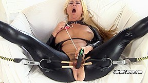 Hot MILF Joclyn Stone gets satisfaction with pegs and black toy. Big busty perfect woman toys her hairy cunt with black dildo and clothes pegs