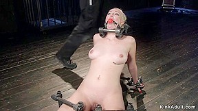 Blonde lean back in metal device bondage. Natural blonde slave Jenna Ivory on knees kean back in metal device bondage with locked head gets pussy vibed and tormented in dungeon