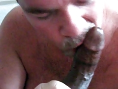 Mature stud sucks on a throbbing black cock hungrily. Check out Mature stud sucks on a throbbing black cock hungrily on FRPRN.com