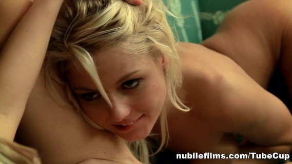 NubileFilms Video: Blonde Beauties. Blonde lovers Grace Hartley and Jasmina are getting ready for a night out, but after Grace starts caressing and kissing her woman their plans change to a night of passion. After shedding their clothes, the girls come together on the couch and exchange eager passionate kisses peppered with touches to each other's sensitive breasts that are meant to ignite pleasure. Grace is the first to break off the loving kisses, dipping her head down to lick and sample Jasmina's diamond hard nipples. Loving the taste, Grace crawls closer and begins to suckle her woman's puckered nipples in earnest. Kissing her way down Jasmina's body, Grace eventually coaxes her woman to straddle her upper body. The position puts Jasmina's wet tender pussy within perfect licking range for Grace, who applies herself to the task with unrestrained eagerness. Soon, Jasmina is gasping and moaning in joy as Grace works her magic tongue. Wanting to send her lover over the edge of passion, Grace shifts so that Jasmina is lying on her back on the couch with her thighs parted. Grace leans in and probes her woman's dripping twat with her tongue and fingers as she finishes Jasmina' off and helps her ride through the pleasure of her orgasm. Jasmina is only too happy to repay her lover the pleasure that was given to her. She trails her tongue down Grace's flat belly and then makes herself at home between Grace's slender long legs. After making sure that her lover is warmed up with her fingers and mouth, Jasmina uses a vibrating toy to drive Grace wild! She lubricates the blunt tip with the wetness dripping from Grace's shaved slit, and then presses the toy deep into Grace's tight sheathe while licking at her lover's needy clit. Unable to hold herself back, Grace flies apart as the pleasure flows through her in the form of a soul-shattering climax.