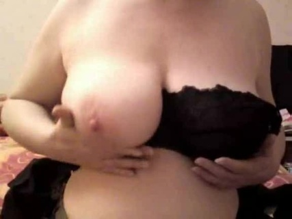 Pale chubby woman takes off her black blouse and shows her tits