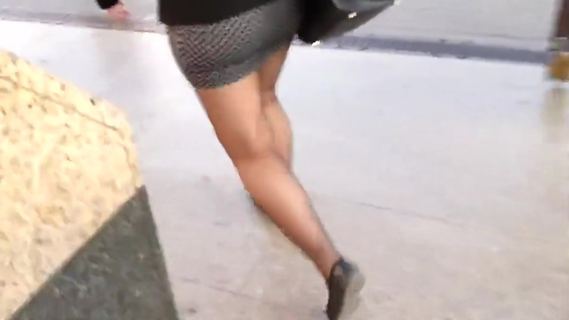 Tight miniskirt sheer black pantyhose and flats. Tight miniskirt sheer black pantyhose and flats