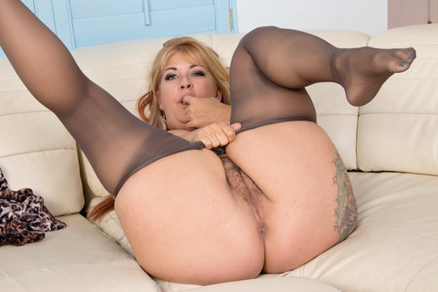 Hairy milf Joclyn Stone gets turned on in pantyhose. Chunky milf Joclyn Stone enjoys rubbing her nyloned fingers over her sensitive clit. Bonus video: American milf Vivi.