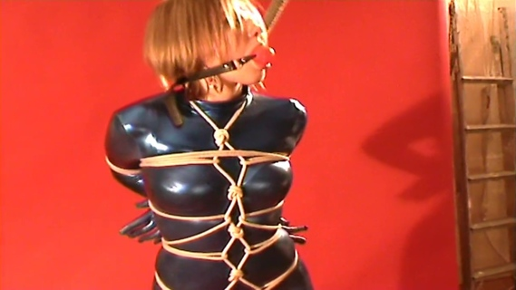bleu catsuit and ball gagged. bleu catsuit and ball gagged