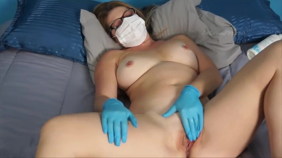 Sexy nurse masturbates in latex gloves and surgical mask. Sexy nurse masturbates in latex gloves and surgical mask