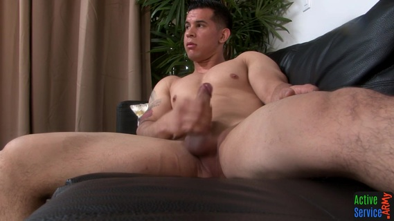 Straight military hunk jerks off on the couch. Straight military hunk jerks off on the couch after oiling up his dong