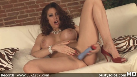 Sheila Marie fondles her cunt with a dildo. Sheila Marie