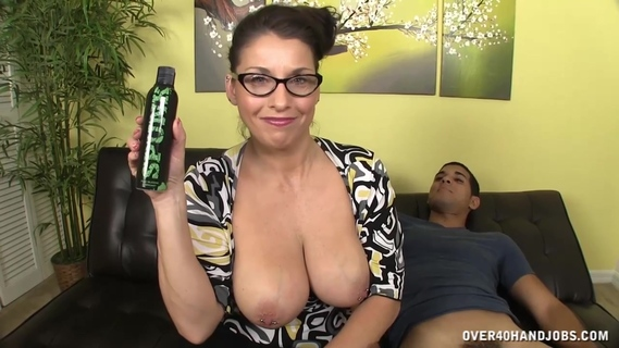 A busty woman is jerking off this cock. Stacie Starr